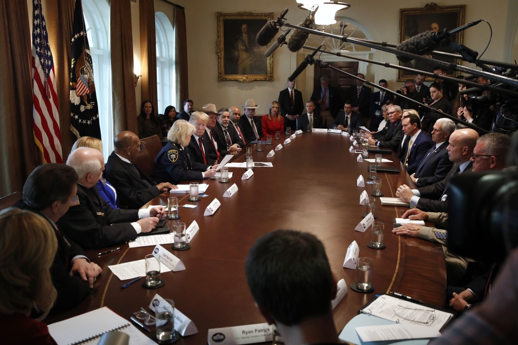 President Donald Trump, center left, leads a roundtable discussion on border security with local leaders, Friday Jan. 11, 2019, in the Cabinet Room of...