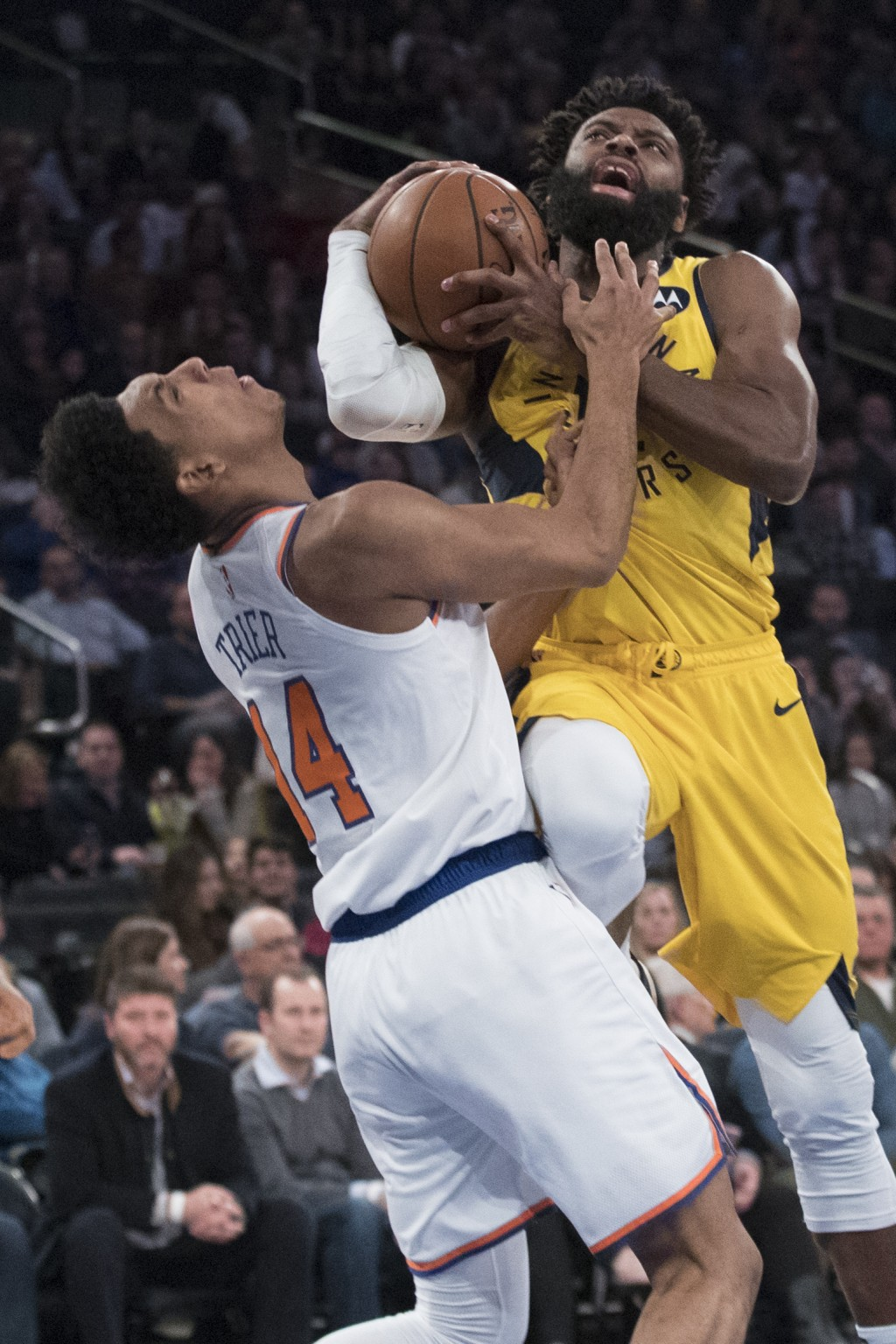 New York Knicks guard Allonzo Trier (14) fouls Indiana Pacers guard Tyreke Evans during the first half of an NBA basketball game Friday, Jan. 11, 2019