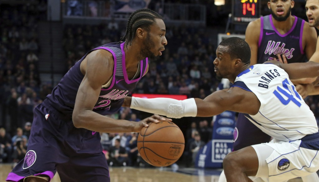 Minnesota Timberwolves' Andrew Wiggins, left, drives as Dallas Mavericks' Harrison Barnes defends in the first half of an NBA basketball game Friday,