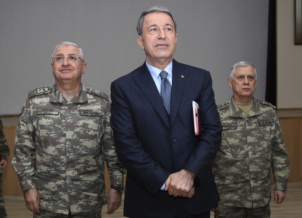 Turkey's Defence Minister Hulusi Akar listens during a meeting with the commanders of military units on Syrian border in Sanliurfa, southeastern Turke
