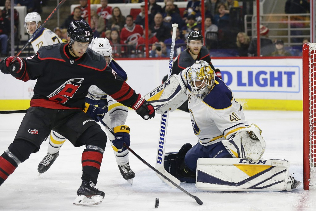 Carolina Hurricanes' Sebastian Aho (20), of Finland, looks for a shot on goal in front of Buffalo Sabres goalie Carter Hutton (40) during the second p