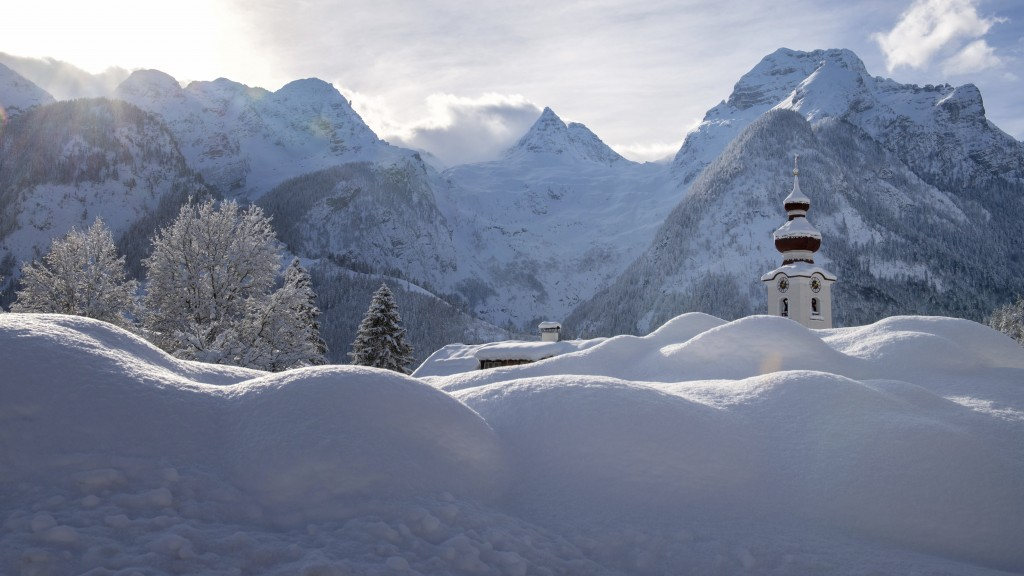 The steeple of the Loferer church is seen through the snow in Lofer, Austrian province of Salzburg on Friday, Jan. 11, 2019 after a heavy snowfall. (A