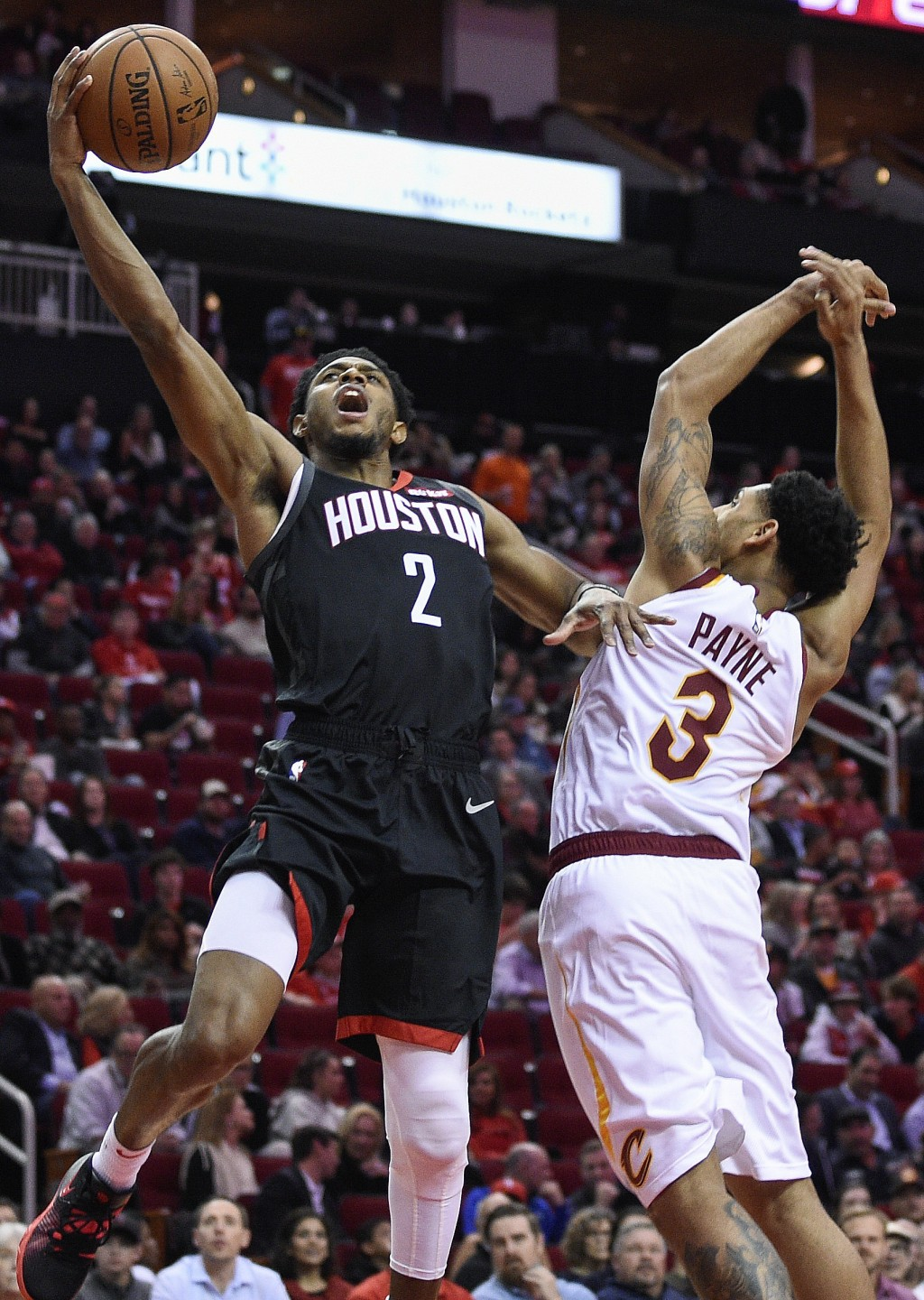 Houston Rockets guard Brandon Knight (2) drives to the basket past Cleveland Cavaliers guard Cameron Payne during the first half of an NBA basketball