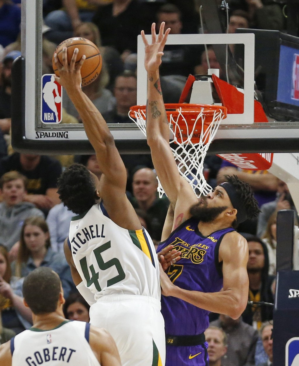 Utah Jazz guard Donovan Mitchell (45) dunks on Los Angeles Lakers center JaVale McGee (7) during the first half of an NBA basketball game Friday, Jan.