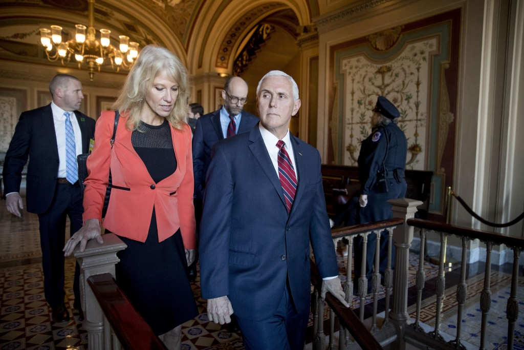In this Jan. 10, 2019, photo, Vice President Mike Pence and counselor to the President Kellyanne Conway, leave Pence's office off the Senate floor in