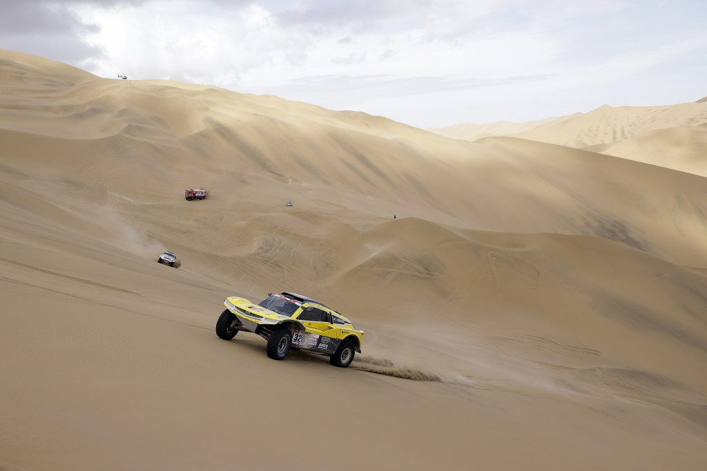 Driver Philippe Gache, of France, and co-driver Stephane Prevot, of Belgium, race their Buggy during the stage five of the Dakar Rally between Tacna a
