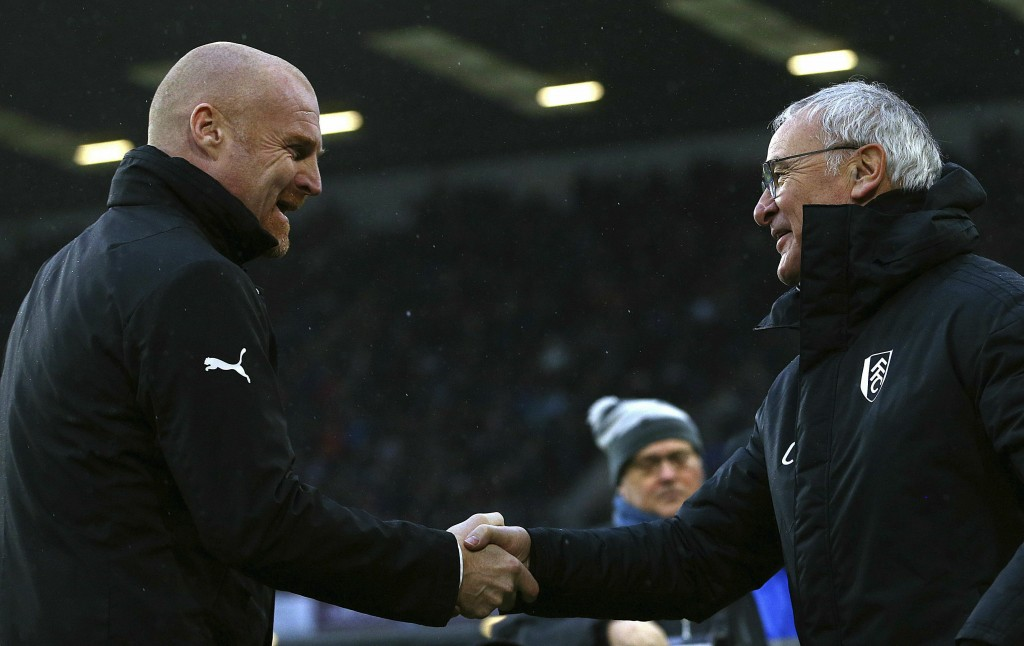 Burnley manager Sean Dyche, left, greets Fulham manager Claudio Ranieri during the English Premier League soccer match between Burnley F.C and Fulham