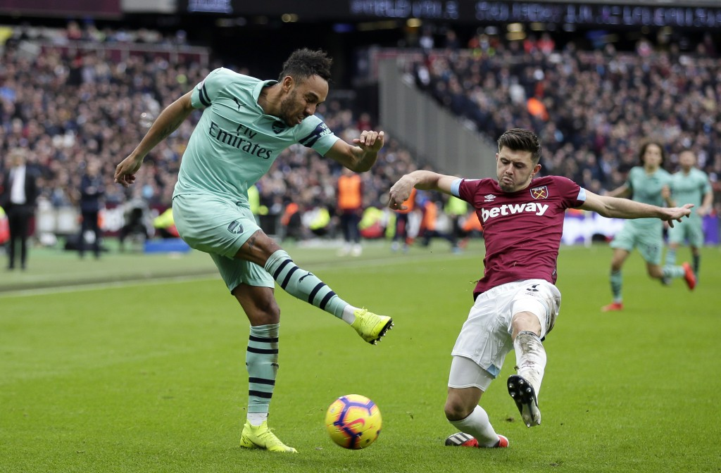 Arsenal's Pierre-Emerick Aubameyang attempts a shot during the English Premier League soccer match between West Ham United and Arsenal at London Stadi