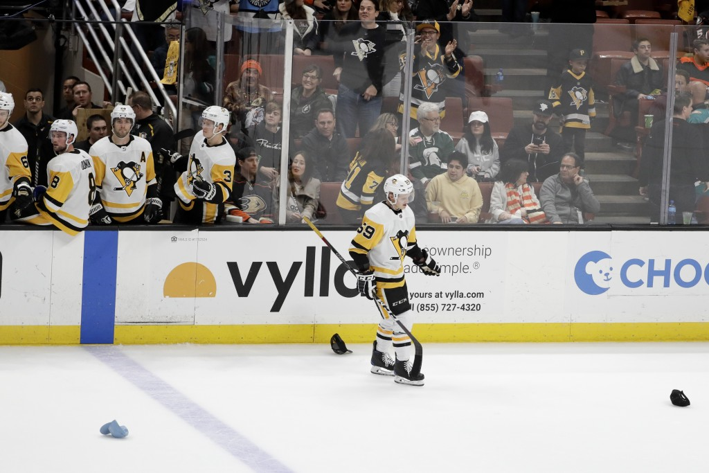 Pittsburgh Penguins left wing Jake Guentzel celebrates after scoring a hat trick against the Anaheim Ducks, during the third period of an NHL hockey g