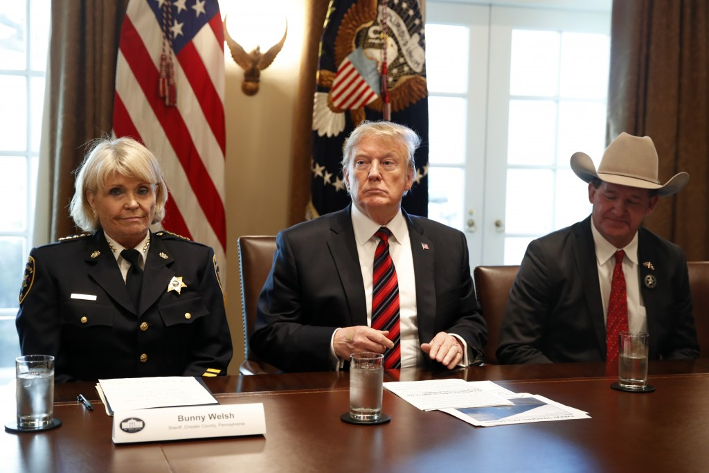 "President Donald Trump, with Carolyn ""Bunny"" Welsh, sheriff of Chester County, Pa., left, and AJ Louderback, sheriff of Jackson County, Texas, attends"
