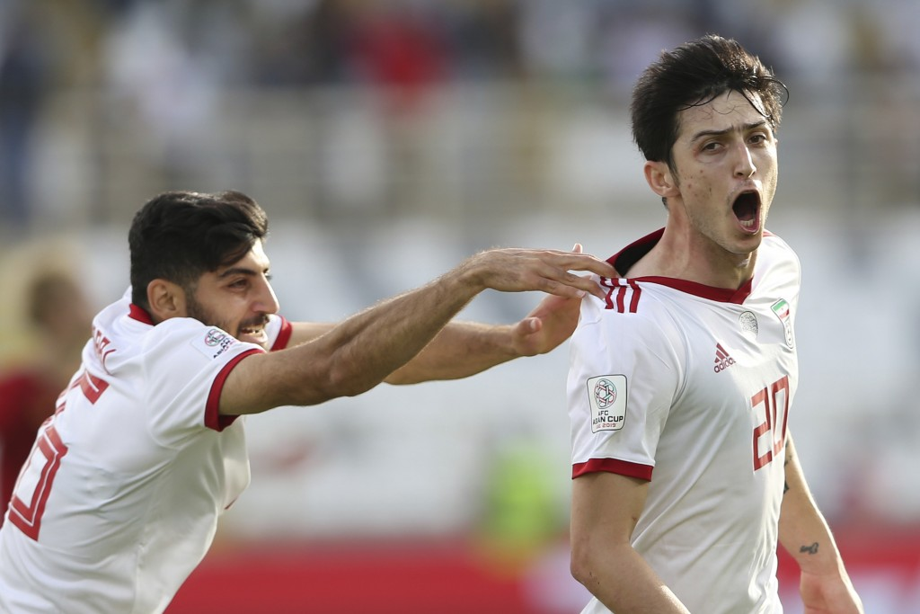 Iran's forward Sardar Azmoun, right, celebrates after scoring his side's second goal during the AFC Asian Cup group D soccer match between Iran and Vi