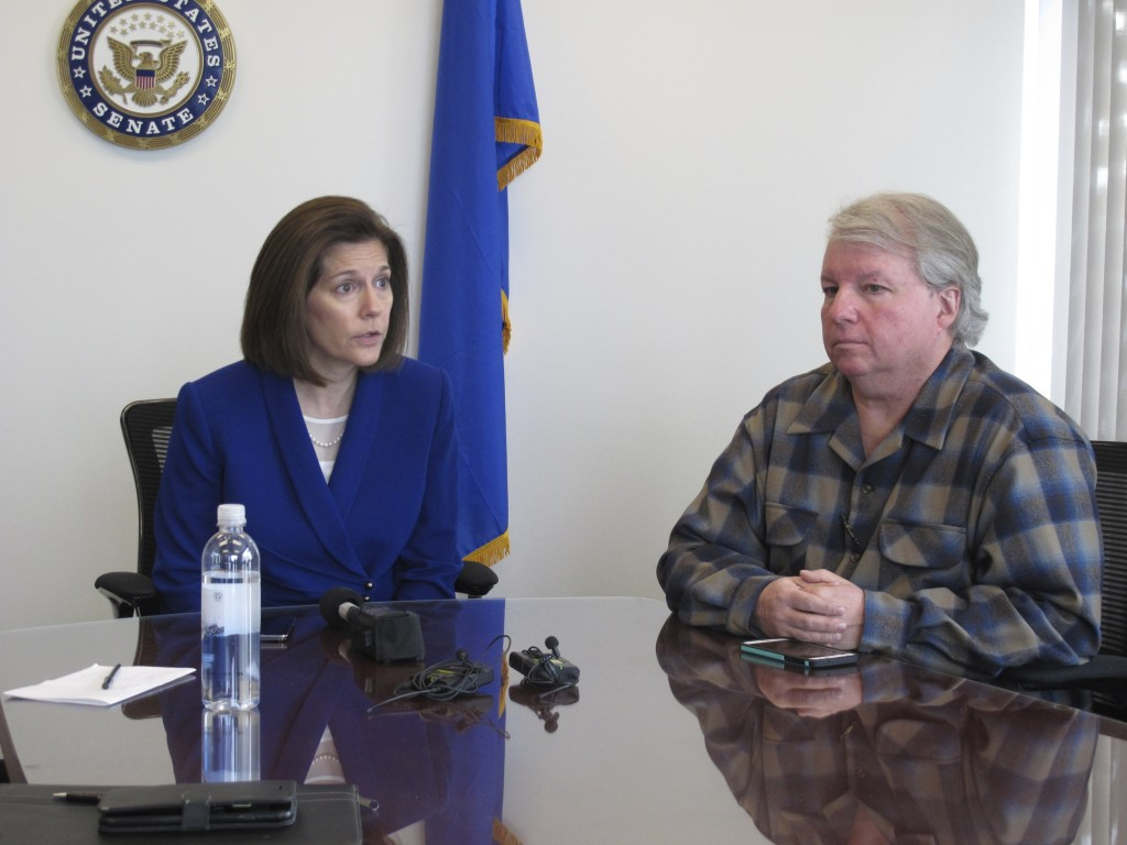 David Pritchett, a furloughed worker for the U.S. Bureau of Land Management, looks on as Sen. Catherine Cortez Masto, D-Nev., talks to reporters Frida