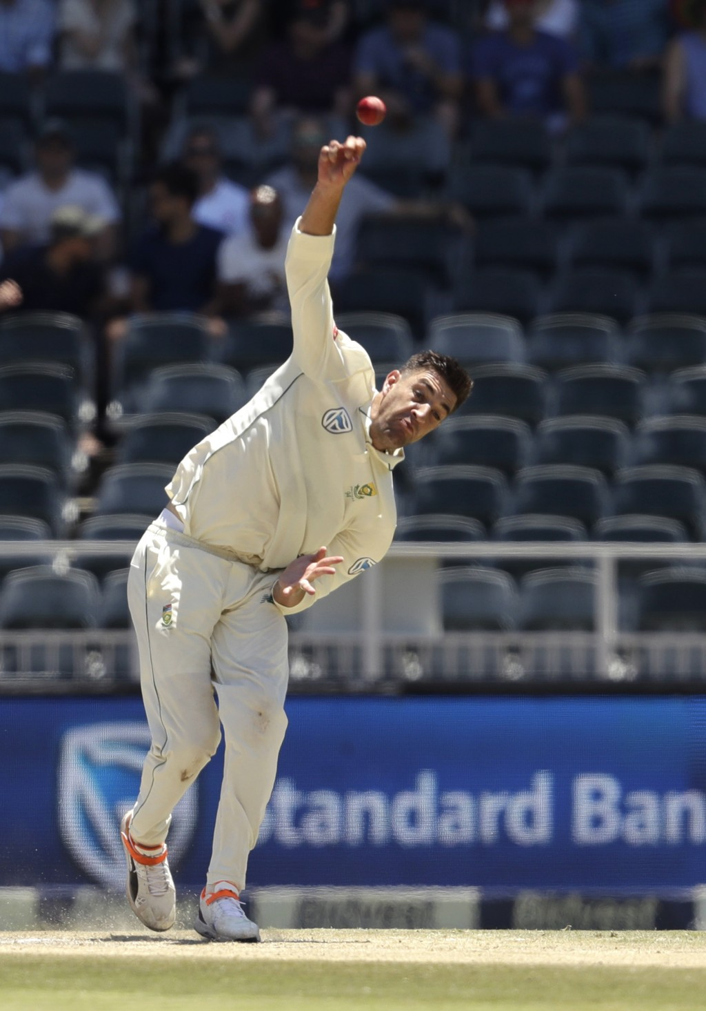 South Africa's bowler Duanne Olivier bowls on day two of the third cricket test match between South Africa and Pakistan at the Wanderers stadium in Jo
