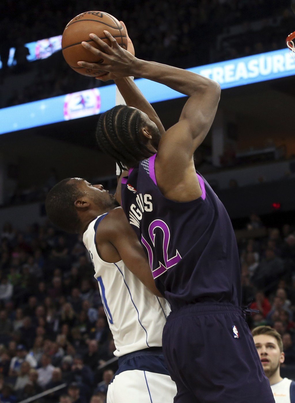 Minnesota Timberwolves' Andrew Wiggins, right, shoots as Dallas Mavericks' Harrison Barnes defends against him in the first half of an NBA basketball