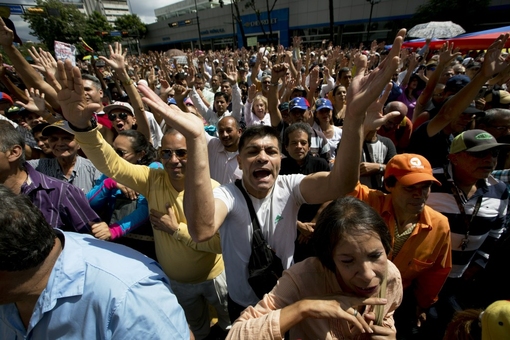 """Opposition members shout """"Guaido President"""" during public a session of National Assembly at a street in Caracas, Venezuela, Friday, Jan. 11, 2019. Jua..."""