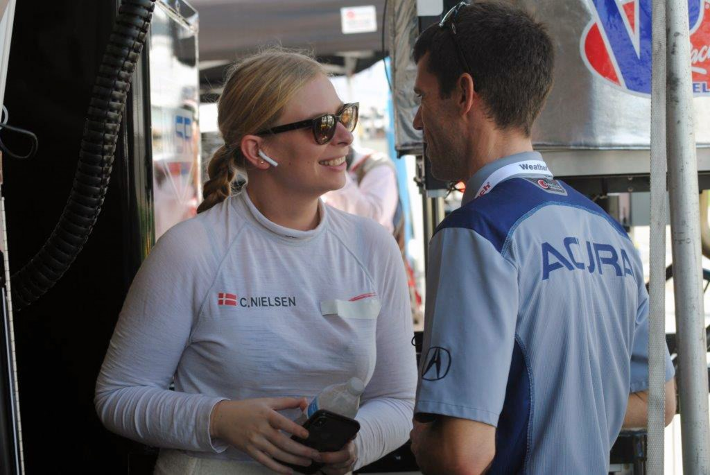 Christina Nielsen of Denmark chats with a crew member during a test session at Daytona International Speedway in Daytona Beach, Fla., Friday, Jan. 4,