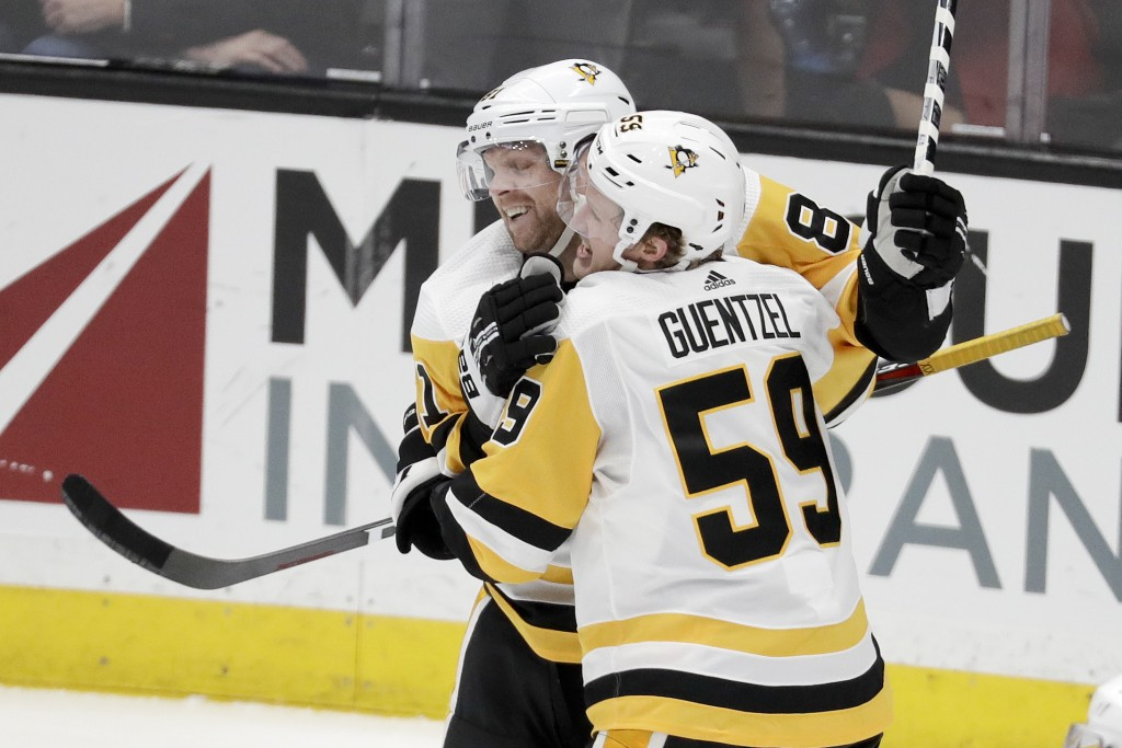 Pittsburgh Penguins left wing Jake Guentzel (59) celebrates his goal with right wing Phil Kessel during the second period of an NHL hockey game agains