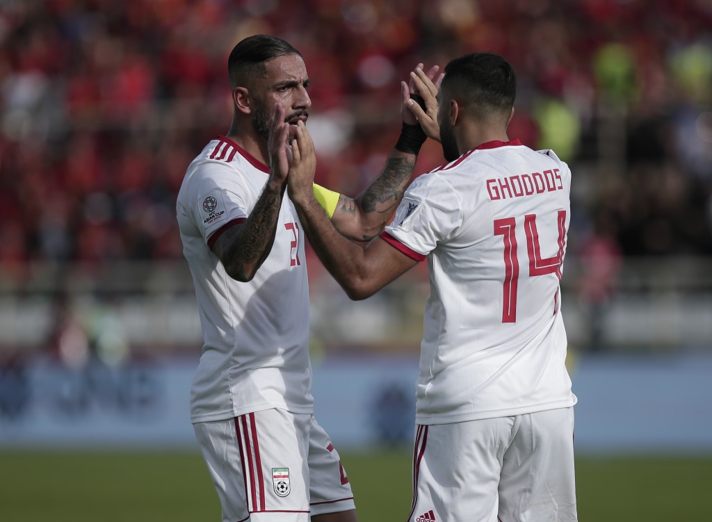 Iran's Ashkan Dejagah, left, and Saman Ghoddos celebrate their team's first goal during the AFC Asian Cup group D soccer match between Iran and Vietna