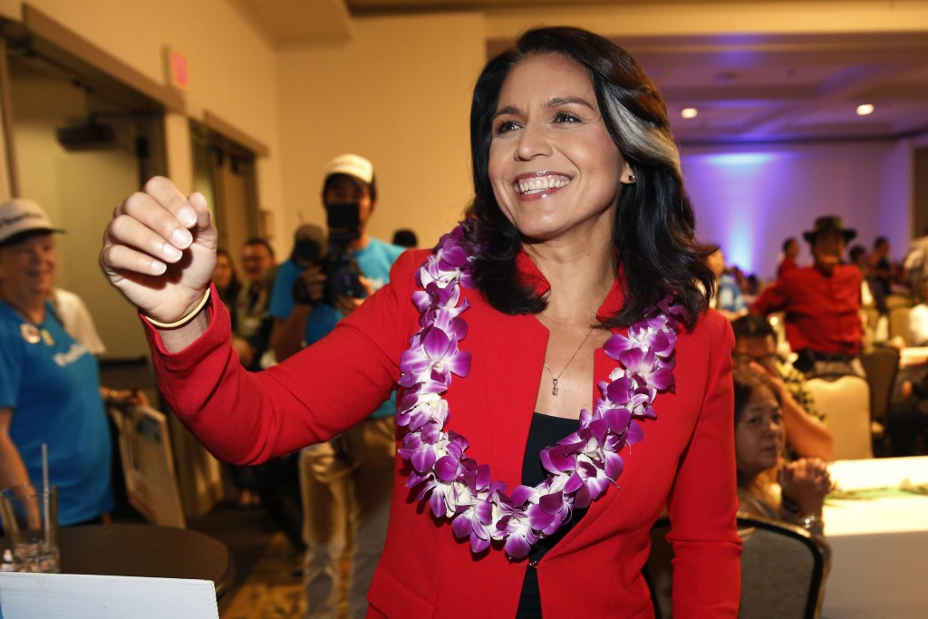 FILE - In this Nov. 6, 2018, file photo, Rep. Tulsi Gabbard, D-Hawaii, greets supporters in Honolulu. Gabbard has announced she's running for presiden