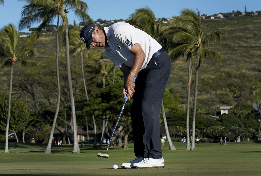 Matt Kuchar putts on the 13th green during the second round of the Sony Open PGA Tour golf event, Friday, Jan. 11, 2019, at Waialae Country Club in Ho