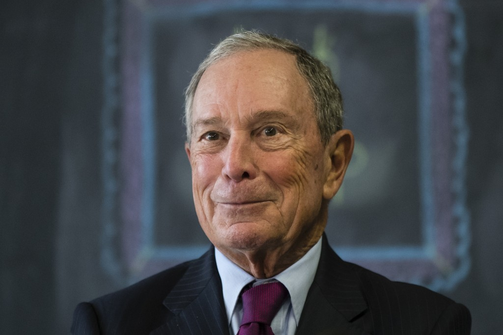 FILE - In this Nov. 30, 2018 file photo, former New York Mayor Michael Bloomberg speaks with members of the media at The Bridge Way School in Philadel