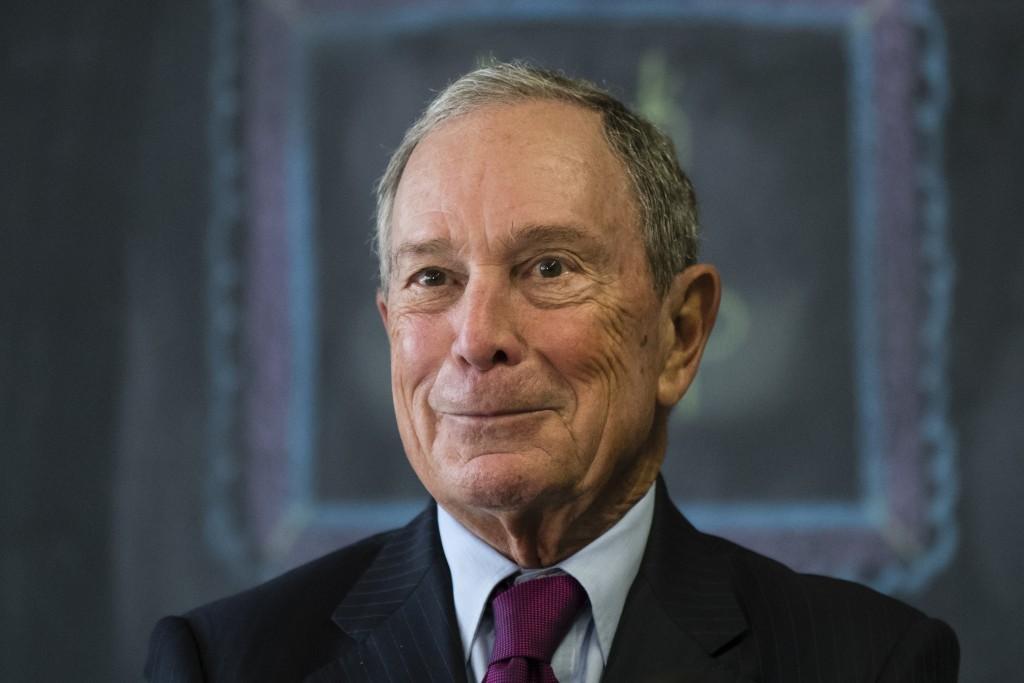FILE - In this Nov. 30, 2018 file photo, former New York Mayor Michael Bloomberg speaks with members of the media at The Bridge Way School in Philadel...