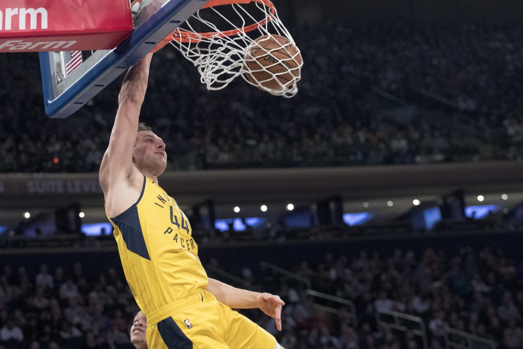 Indiana Pacers forward Bojan Bogdanovic dunks during the first half of the team's NBA basketball game against the New York Knicks, Friday, Jan. 11, 20