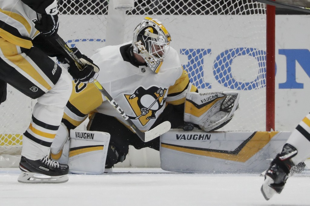 Pittsburgh Penguins goaltender Matt Murray blocks a shot during the first period of the team's NHL hockey game against the Anaheim Ducks in Anaheim, C