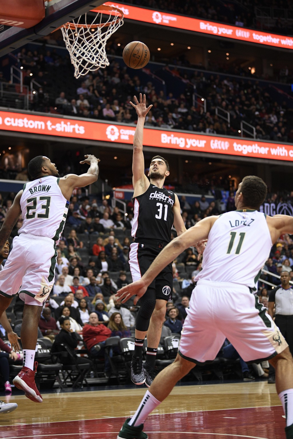 Washington Wizards guard Tomas Satoransky (31) shoots against Milwaukee Bucks guard Sterling Brown (23) and center Brook Lopez (11) during the first h