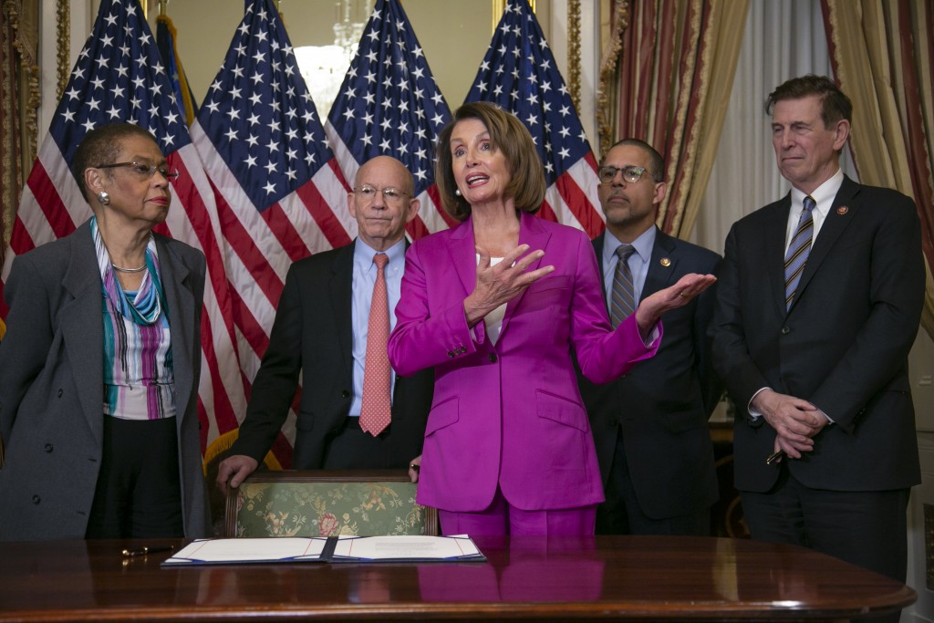 Speaker of the House Nancy Pelosi, D-Calif., talks to reporters after signing a House-passed a bill requiring that all government workers receive retr