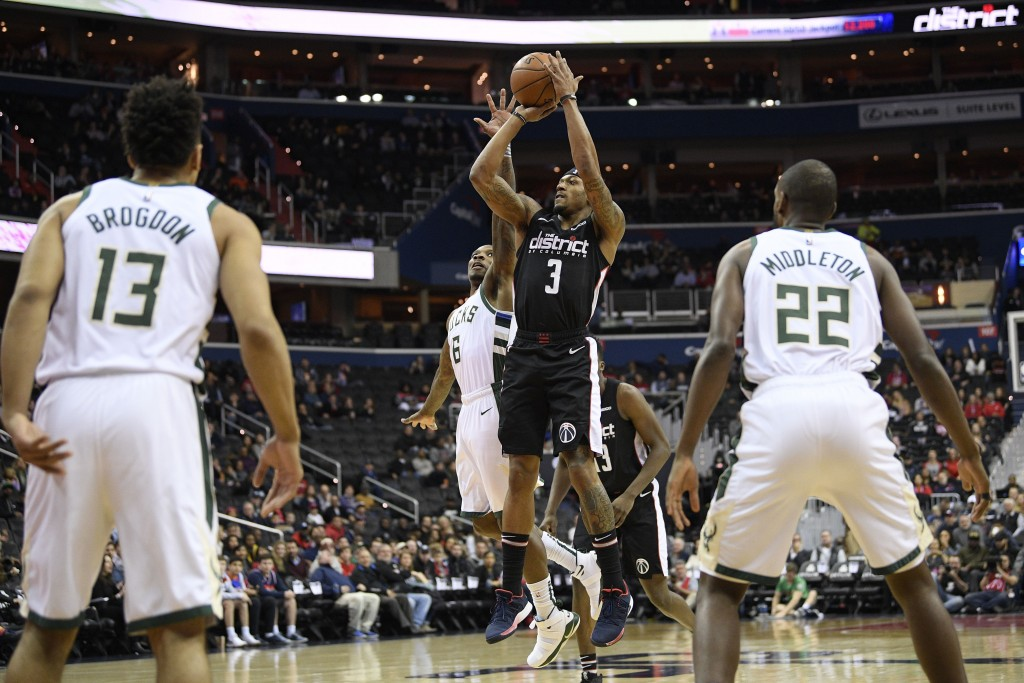 Washington Wizards guard Bradley Beal (3) shoots against Milwaukee Bucks guard Malcolm Brogdon (13), forward Khris Middleton (22) and guard Eric Bleds