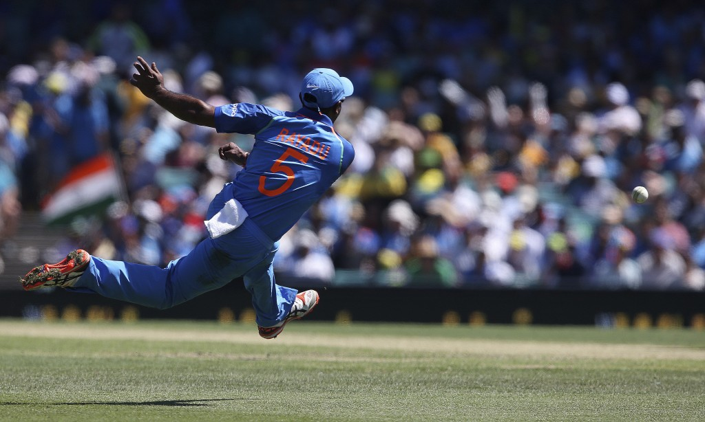 India's Ambati Rayudu throws the ball while fielding against Australia during their one day international cricket match in Sydney, Saturday, Jan. 12,