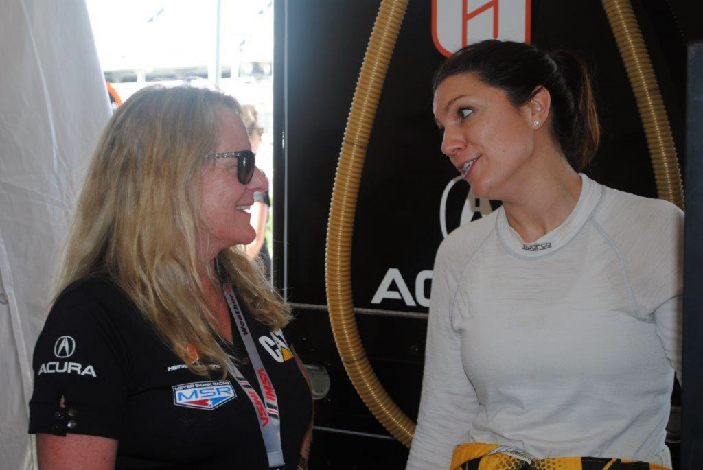 Team owner Jackie Heinricher, left, chats with Katherine Legge, of England, during a test session at Daytona International Speedway in Daytona Beach,