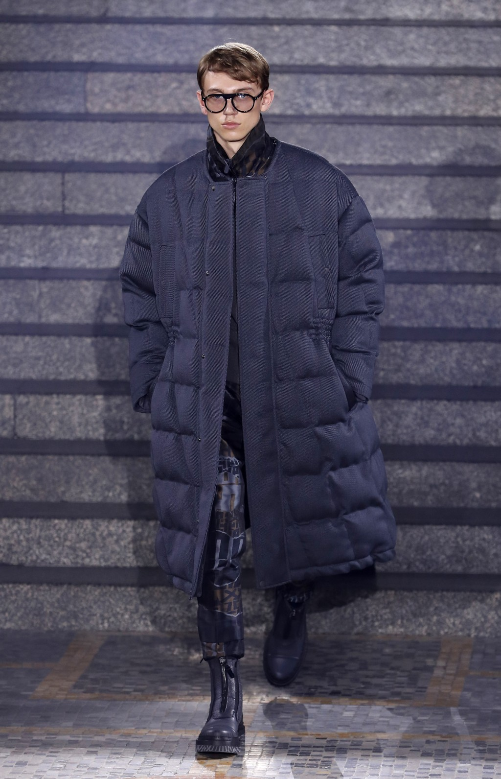 A model wears a creation as part of the Ermenegildo Zegna men's Fall-Winter 2019-20 collection, unveiled during the Fashion Week in Milan, Italy, Frid
