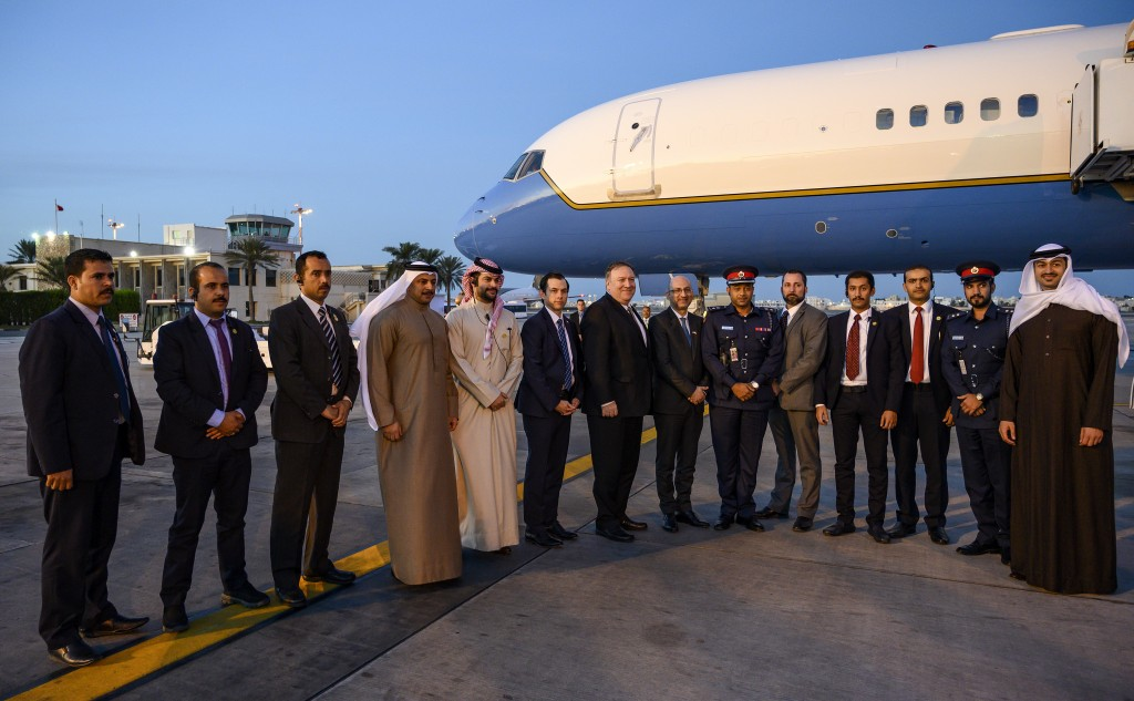U.S. Secretary of State Mike Pompeo, center, poses with his local security team before departing Manama International Airport in Manama, Bahrain, Frid