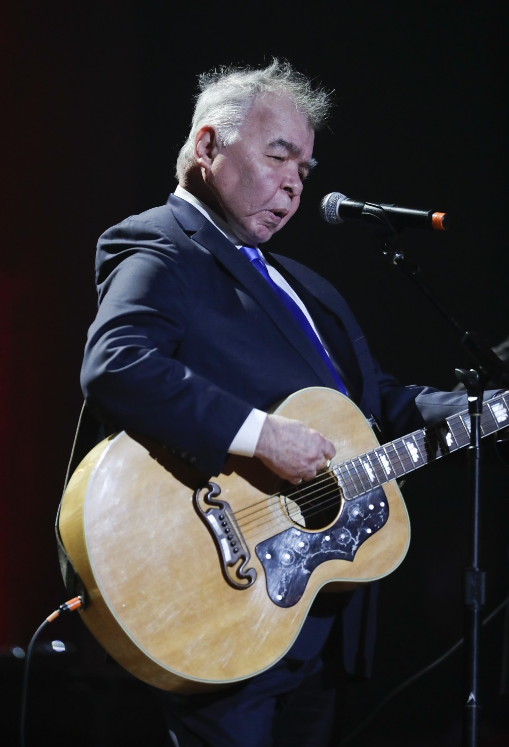 FILE - In this Wednesday, Sept. 13, 2017 file photo, John Prine performs during the Americana Honors and Awards show in Nashville, Tenn. Missy Elliott