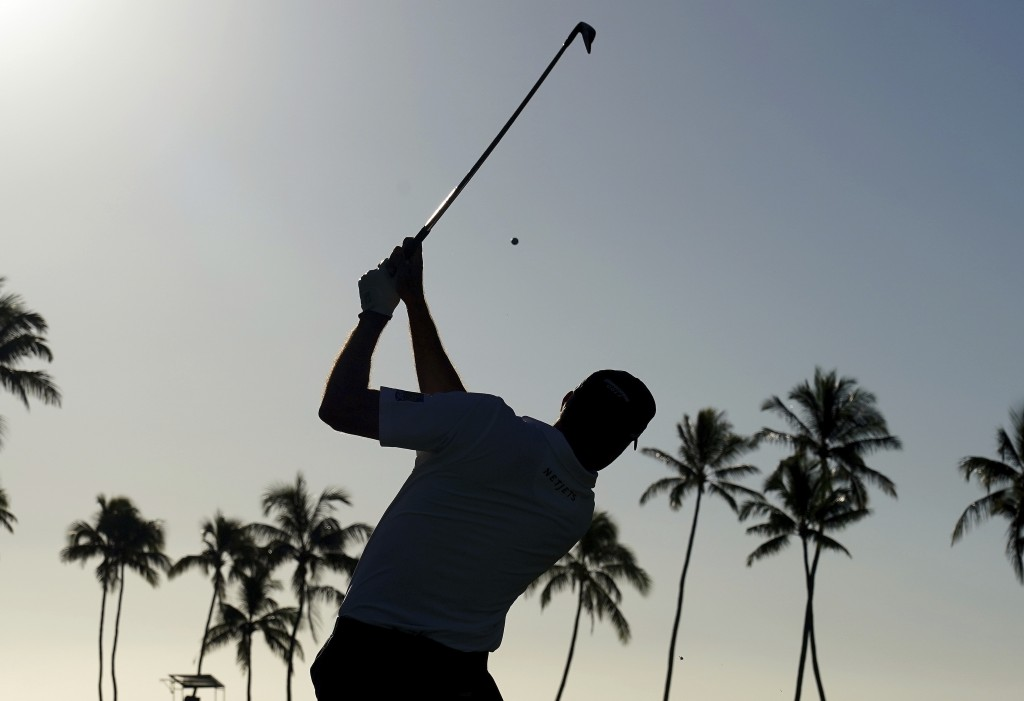 Matt Kuchar hits from the 11th tee during the second round of the Sony Open PGA Tour golf event, Friday, Jan. 11, 2019, at Waialae Country Club in Hon