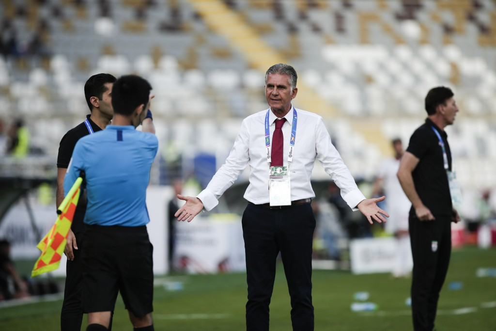Iran's head coach Carlos Queiroz argues with a line referee during the AFC Asian Cup group D soccer match between Iran and Vietnam at Al Nahyan Stadiu