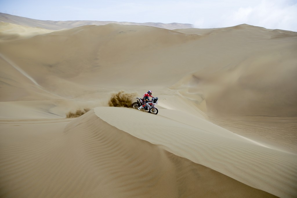Anastasiya Nifontova of Russia rides her Husqvarna motorbike during the stage five of the Dakar Rally between Tacna and Arequipa, Peru, Friday, Jan. 1