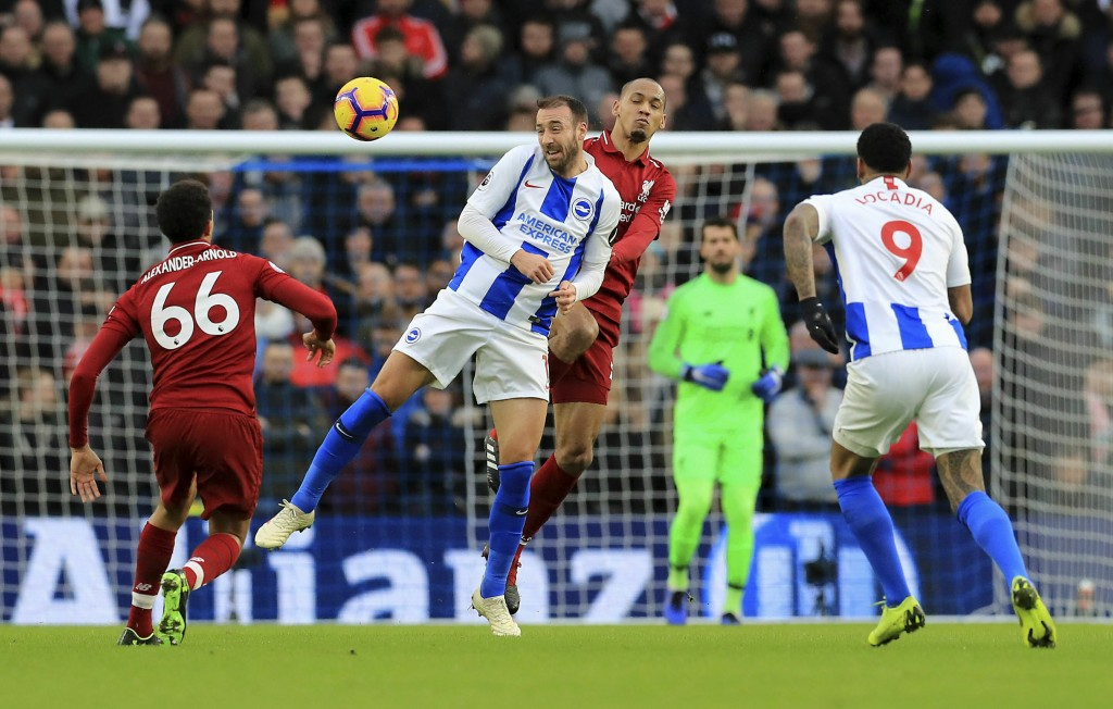 Brighton & Hove Albion's Glenn Murray, left, and Liverpool's Fabinho jump for the ball during the English Premier League soccer match between Brighton