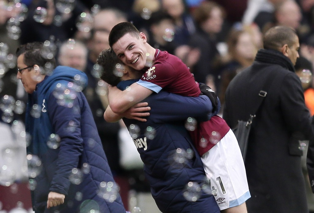 West Ham's Declan Rice celebrates at the end of the English Premier League soccer match between West Ham United and Arsenal at London Stadium in Londo