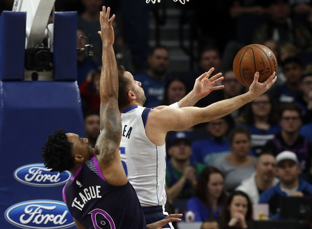 Dallas Mavericks' J.J. Barea, right, prepares to lay up as Minnesota Timberwolves' Jeff Teague defends in the first half of an NBA basketball game Fri