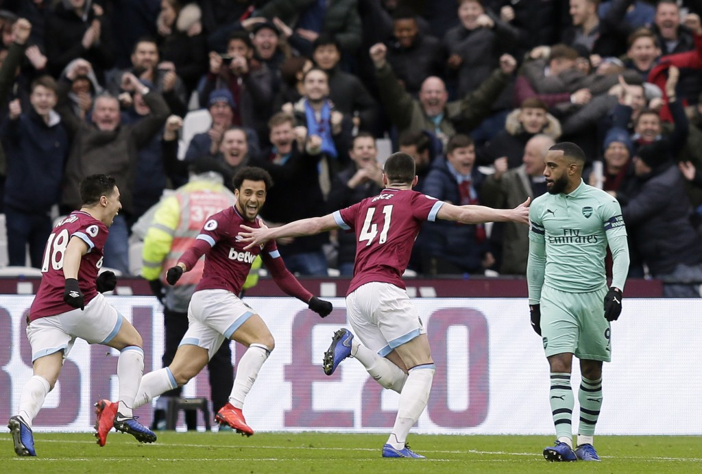 Arsenal's Alexandre Lacazette, right, reacts as West Ham's Declan Rice, 2nd right, celebrates after scoring the opening goal during the English Premie