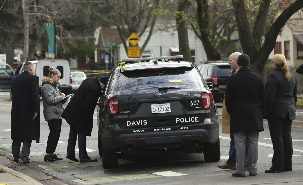 Authorities inspect the patrol vehicle driven by Davis Police Officer Natalie Corona, Friday, Jan. 11, 2019, in Davis, Calif. Corona, 22, who had been