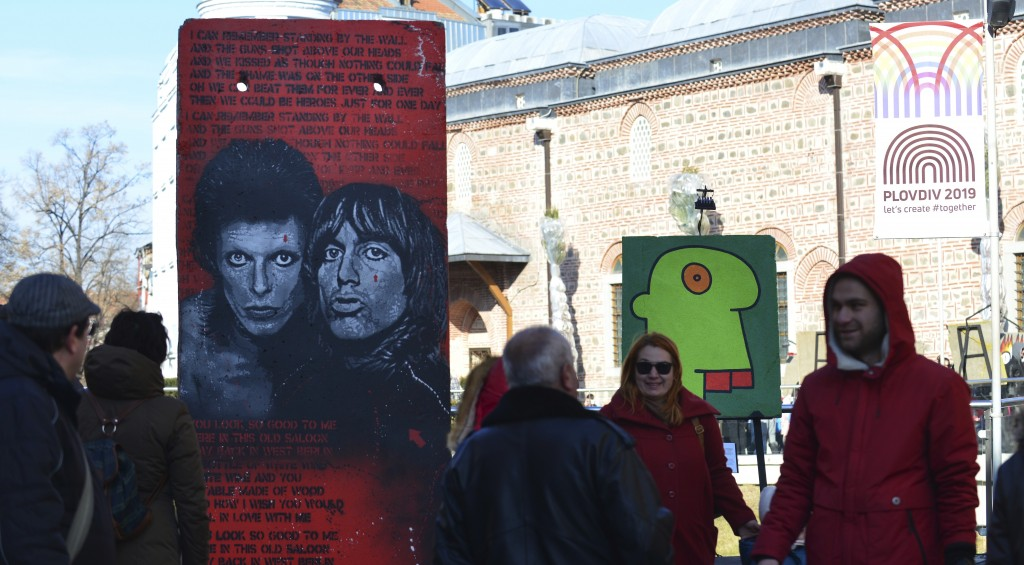 People look at exhibits at the Art Liberte  the first traveling exhibition marking the 30 years anniversary of fall of the Berlin wall in the town of