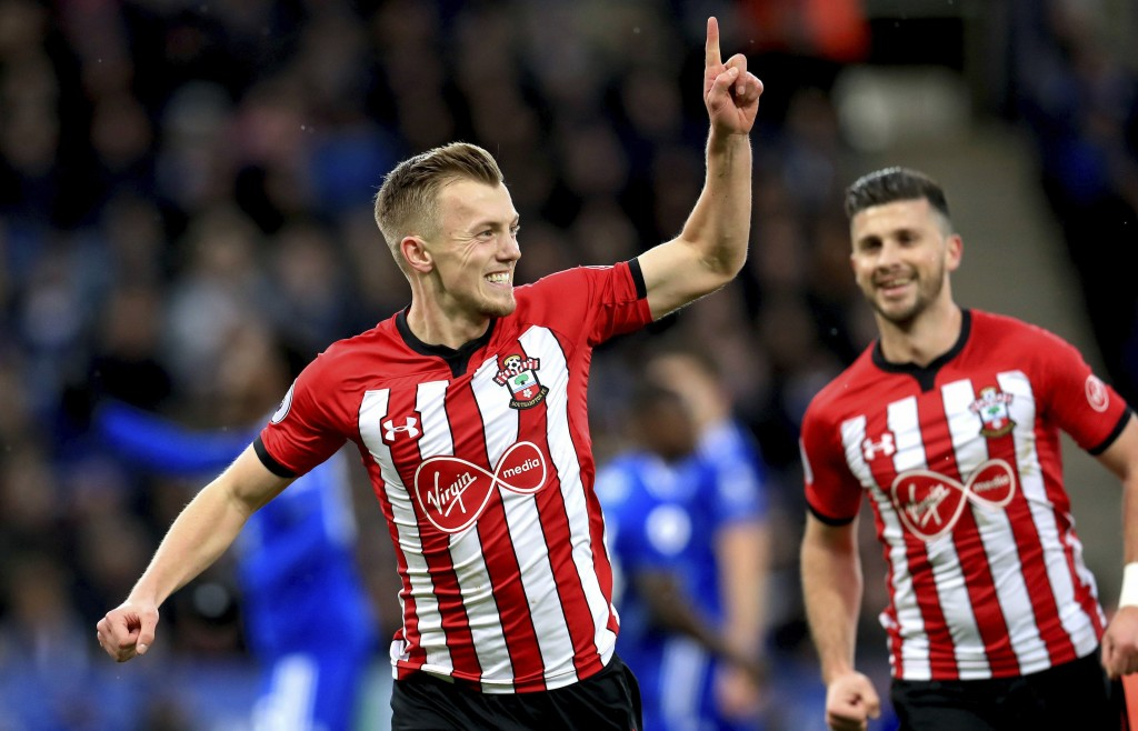 Southampton's James Ward-Prowse, left, celebrates scoring his side's first goal of the game during the English Premier League soccer match between Lei...