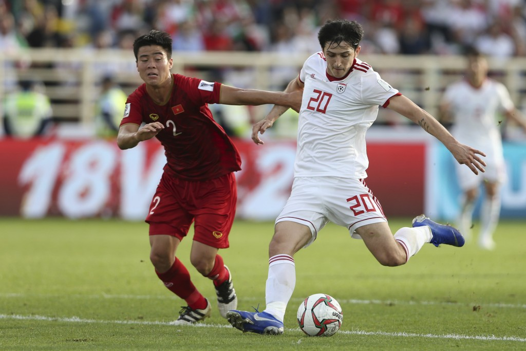 Iran's forward Sardar Azmoun, right, scores his side's second goal during the AFC Asian Cup group D soccer match between Iran and Vietnam at Al Nahyan