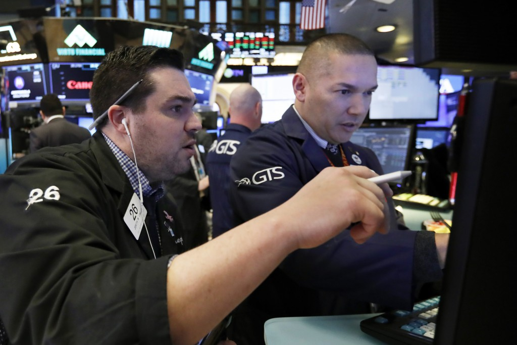 Trader Joseph Lawler, left, and specialist Mark Otto work on the floor of the New York Stock Exchange, Friday, Jan. 11, 2019. Stocks are opening broad