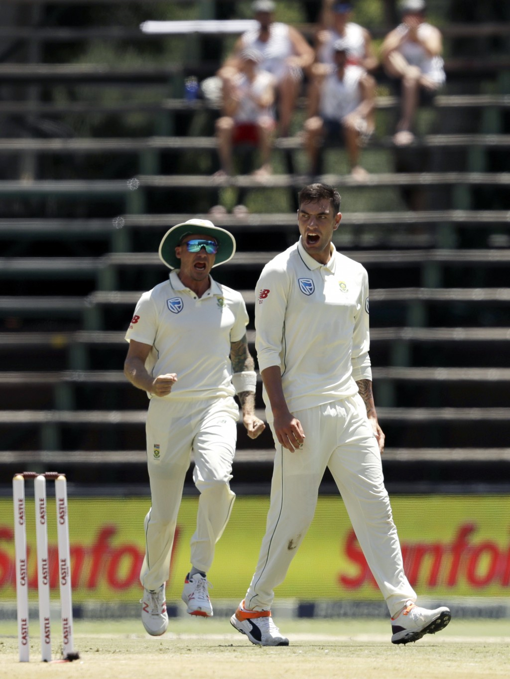 South Africa's bowler Duanne Olivier, right, reacts after dismissing Pakistan's batsman Asad Shafiq for a duck on day two of the third cricket test ma
