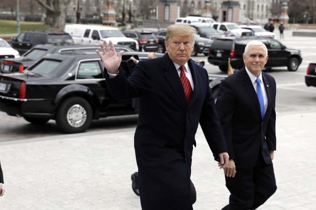 In this Jan. 9, 2019, photo, President Donald Trump arrives with Vice President Mike Pence to attend a Senate Republican policy lunch on Capitol Hill